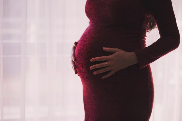 Extending pregnant woman's probation period was discrimination
